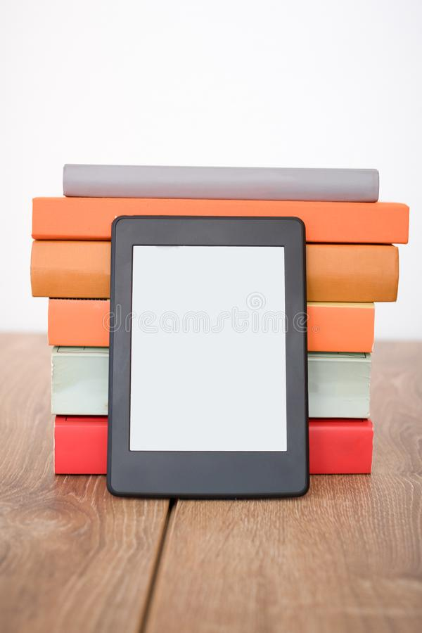 E-book reader on a stack of books royalty free stock photography