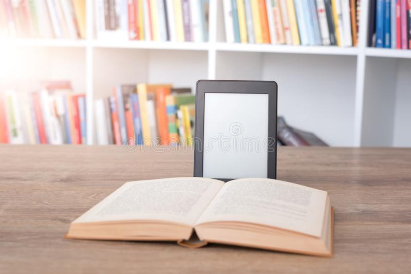 E-book reader on a stack of books royalty free stock image