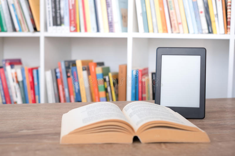 E-book reader on a stack of books stock photography