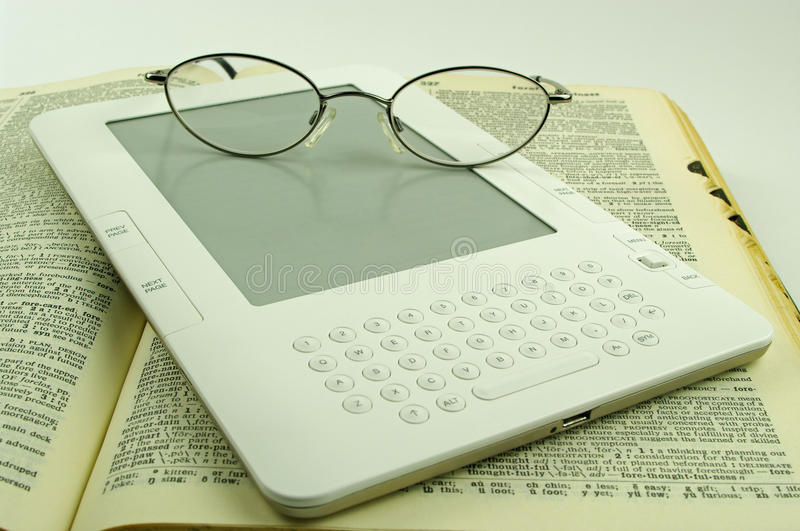E book spectacles and old paper book stock photography