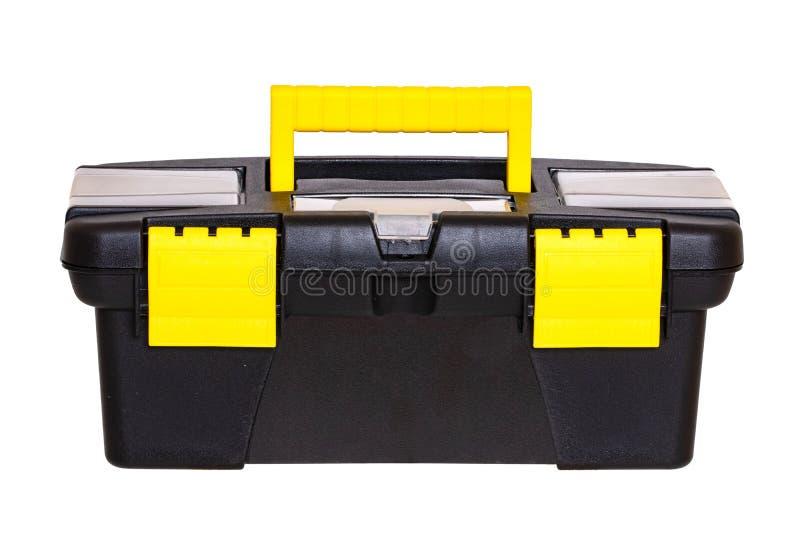 E Close-up van leeg weinig zwarte plastic doos van de hulpmiddeluitrusting met geel die handvat en greep op een wit wordt geïsole stock foto's