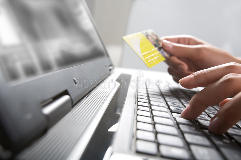 E-commerce. Image of hands holding credit card and pressing a keys of keyboard