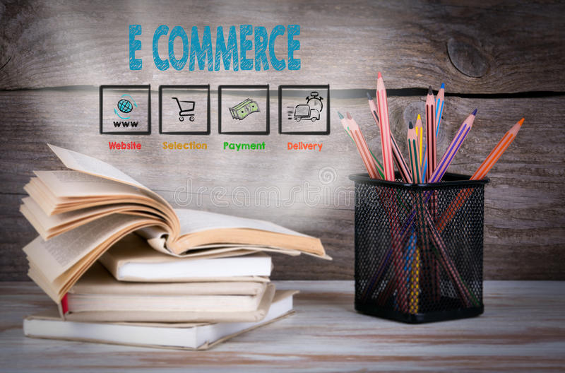 E commerce, Business Concept. Stack of books and pencils on the wooden table. royalty free stock photos