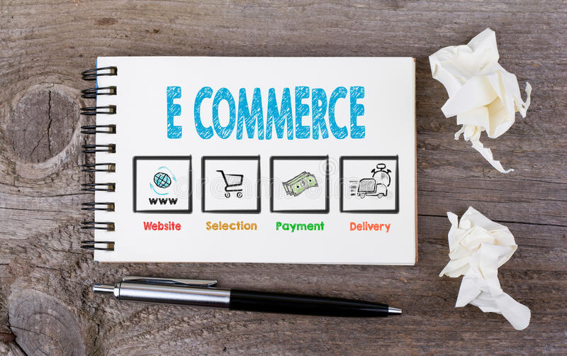 E commerce. Notebook with pen on wooden background royalty free stock photography