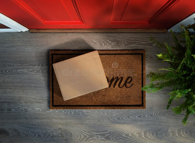 Box with e-commerce purchase delivered to the front door. E-commerce purchase delivered to the front door. Overhead view. Add your own label royalty free stock photo