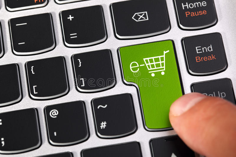 E-commerce shopping cart. Computer keyboard key with shopping cart icon concept for e-commerce, consumerism and internet store checkout