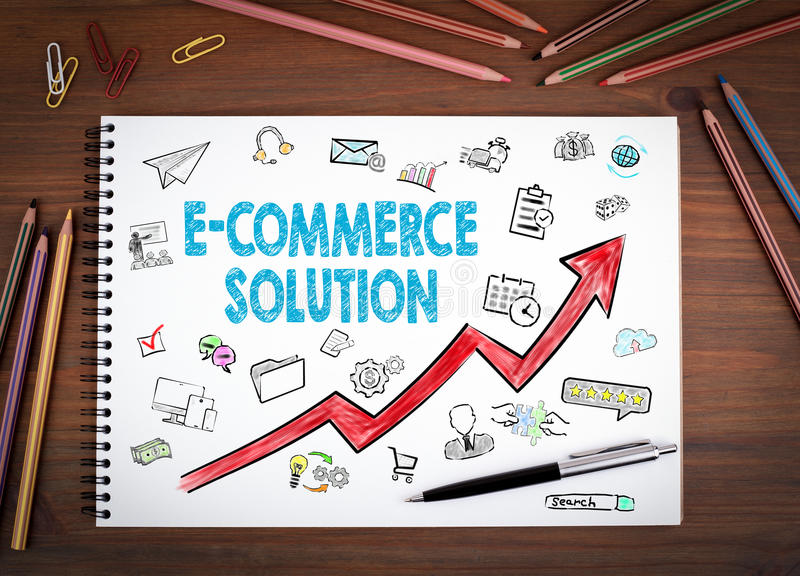 E-Commerce Solution, Business Concept. Notebooks, pen and colored pencils on a wooden table stock illustration