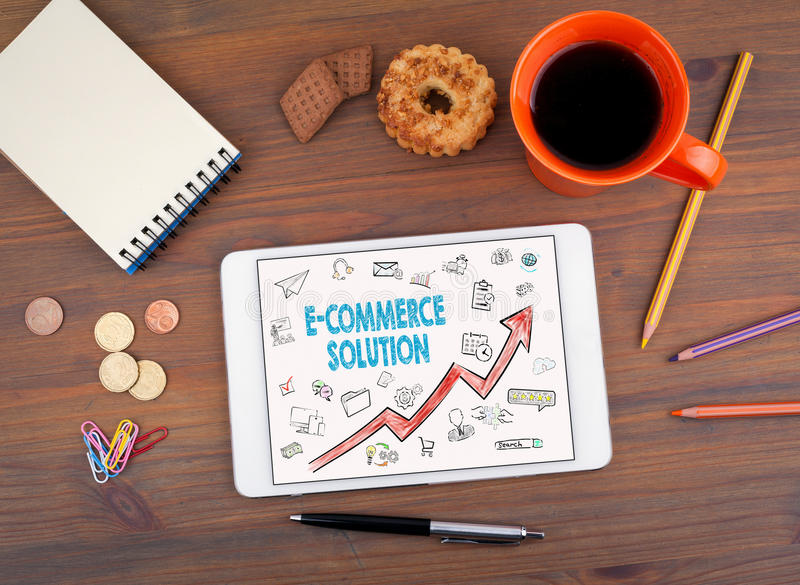 E-Commerce Solution, Business Concept. Tablet on an old wooden table stock images