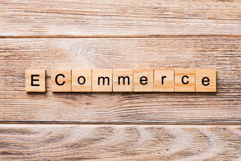 E-commerce word written on wood block. e-commerce text on wooden table for your desing, concept royalty free stock photos