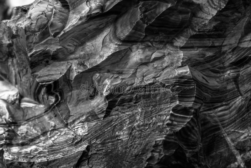E Dunkle Gipssteinbeschaffenheit des vulkanischen Felsens venetianische lizenzfreies stockfoto