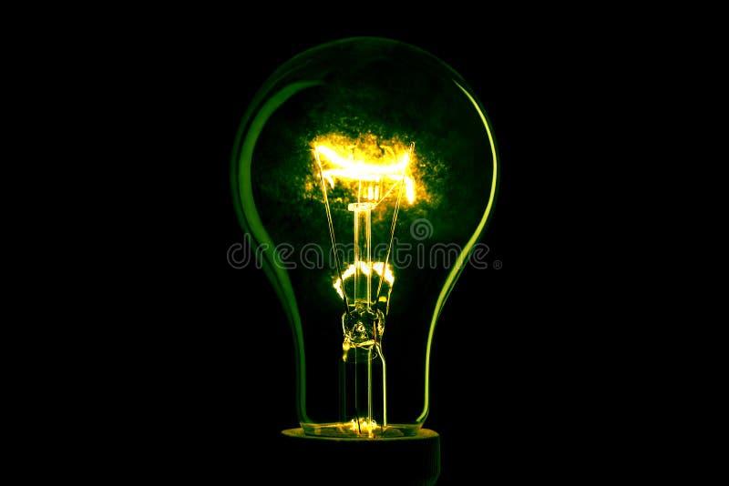 E Indicatore luminoso della lampada nello scuro Lampadina elettrica Ardore leggero nello scuro fotografia stock