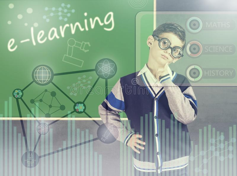 E-learning concept. Little genius boy in front of a chalkboard with digital hud interface and icons royalty free stock photo