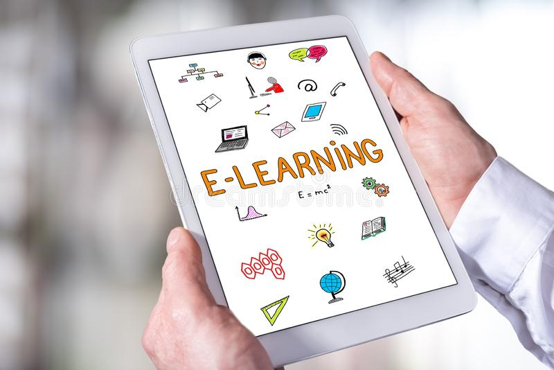 E-learning concept on a tablet. Man holding a tablet showing e-learning concept stock image
