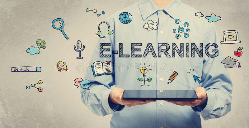 E-learning concept with young man holding a tablet stock images