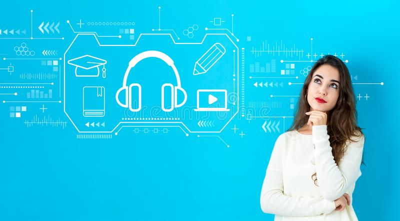 E-learning concept with young woman royalty free stock photo