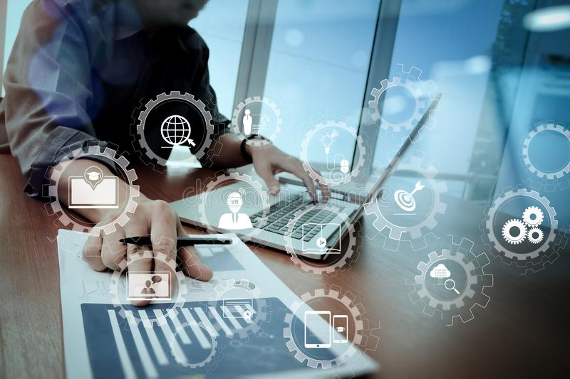 Business documents on office table with smart phone and digital. E-learning with connected gear cogs connected diagram virtual dashboard.business documents on royalty free stock photo