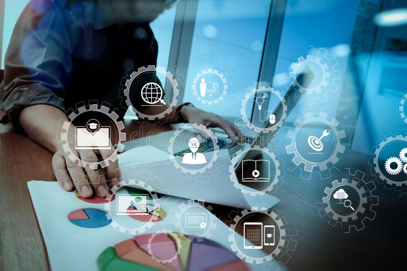 Business documents on office table with smart phone and digital. E-learning with connected gear cogs connected diagram virtual dashboard.business documents on stock images