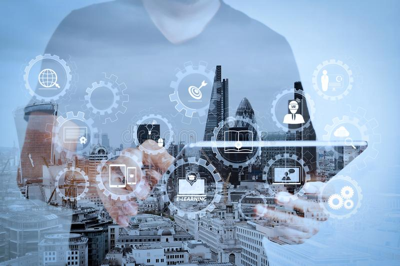 Double exposure of success businessman using digital tablet with. E-learning with connected gear cogs connected diagram virtual dashboard.Double exposure of royalty free stock photos