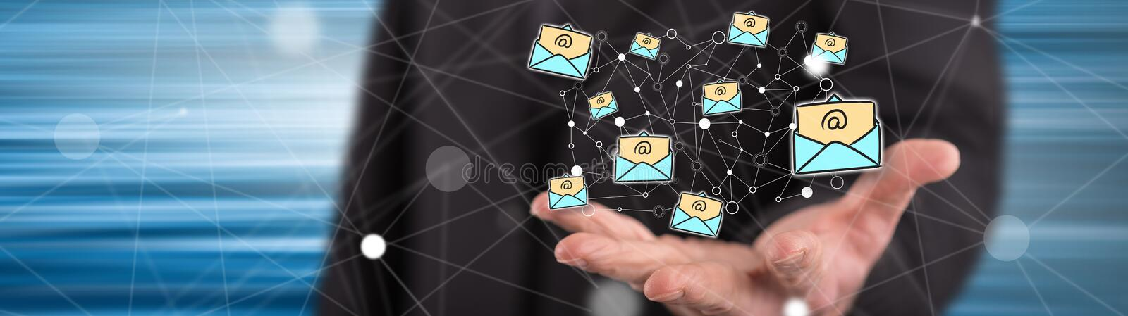 Concept of e-mail. E-mail concept above the hand of a man in background stock image
