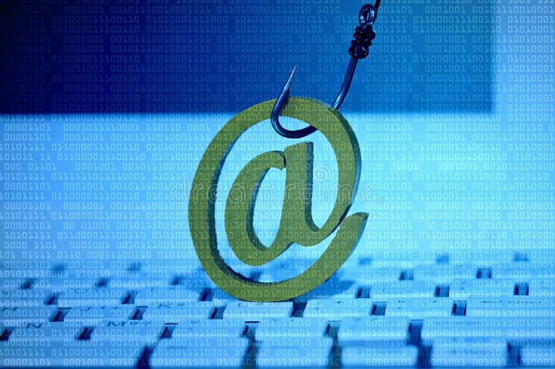 E mail security. Email sign with a fish hook on computer keyboard. Email security and countermeasure concept stock image
