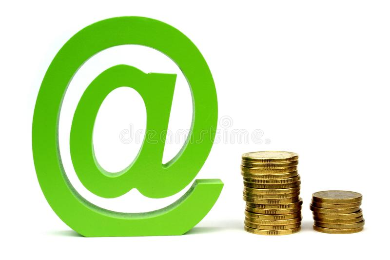 E-mail sign and stacket coins. On white background royalty free stock photography
