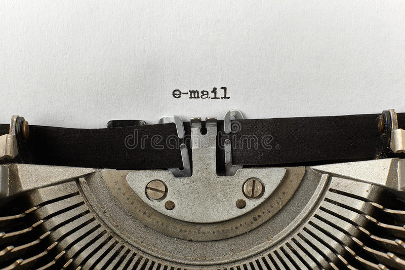 E-mail typed words on a vintage typewriter royalty free stock photography
