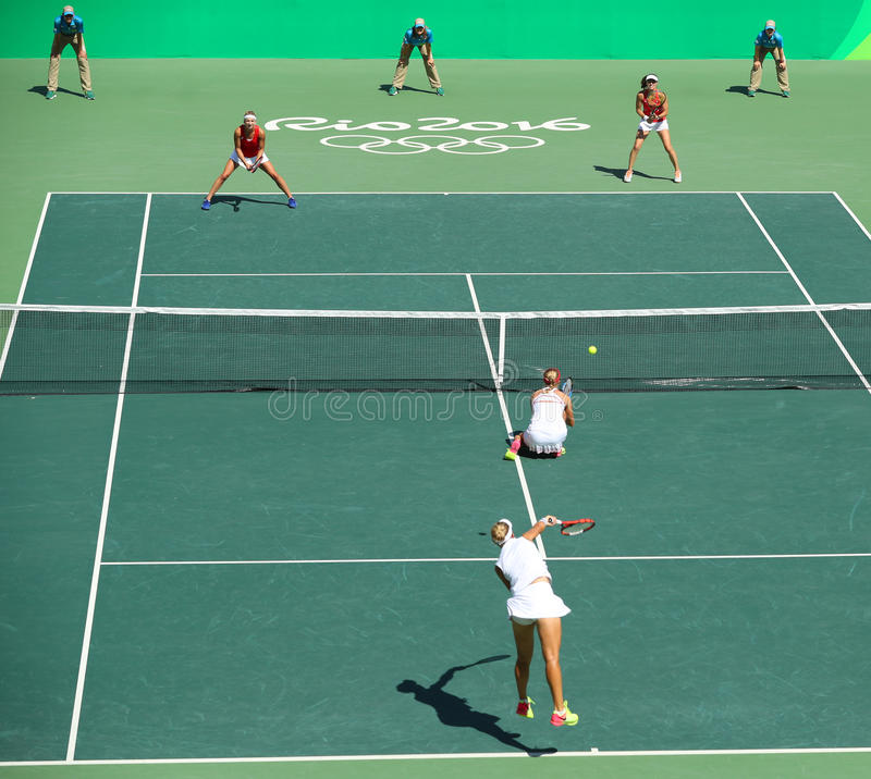 E. Makarova and E. Vesnina of Russia and T. Bacsinszky and M. Hingis of Switzerland in action at women's doubles final. RIO DE JANEIRO, BRAZIL - AUGUST 14, 2016 royalty free stock images