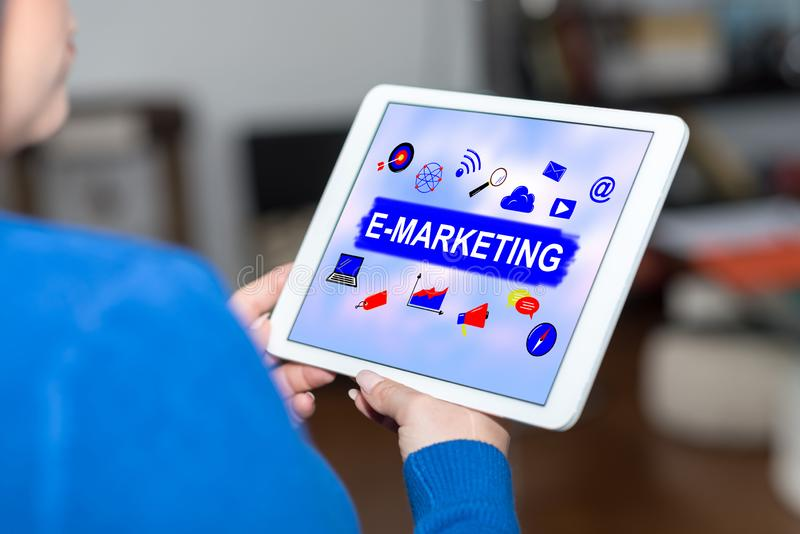 E-marketing concept on a tablet. Tablet screen displaying an e-marketing concept stock photo