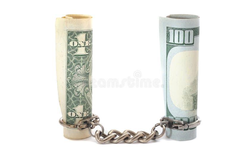 $ 100, e moedas e correntes de $ 1 no fundo branco foto de stock