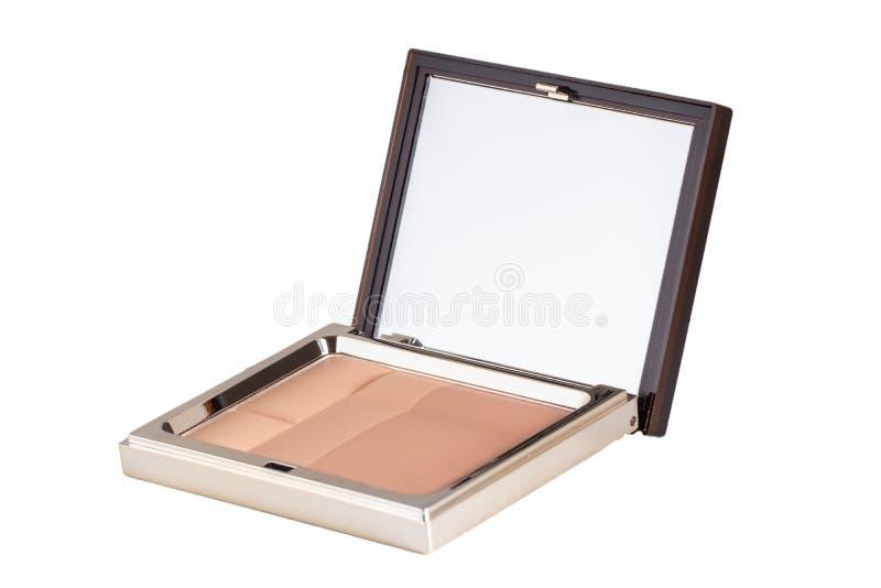 Enskilda kosmetiska produkter Stängning av en elegant kosmetisk låda med skinka eller ansiktspulver Upprätt på vit bakgrund royaltyfri fotografi