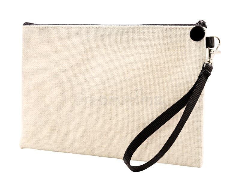 白色背景隔离的坯布袋 亚麻织物材料拉链袋 剪切路径 图库摄影