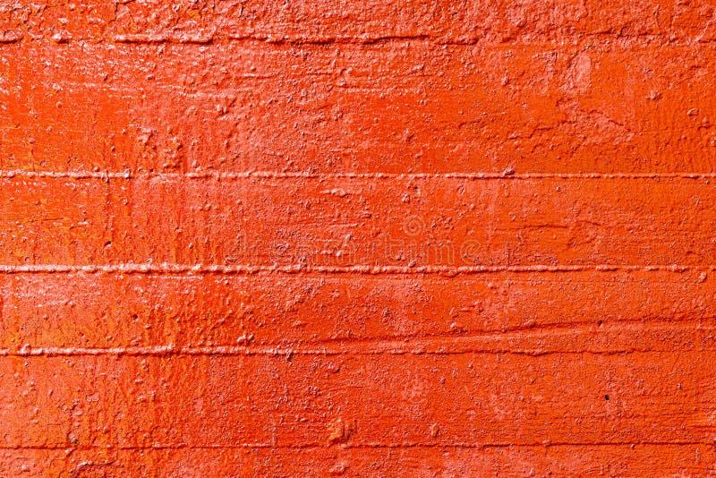 Vecchio muro plastificato dipinto con vernice rossa fresca Sfondo astratto delle pareti rosse chiudere fotografia stock
