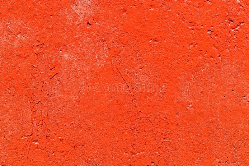 Vecchio muro plastificato dipinto con vernice rossa fresca Sfondo astratto delle pareti rosse chiudere fotografia stock libera da diritti