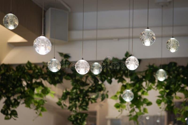 Lampada leggera Chiusa della lampada interna nelle palle di cristallo decorazione interna retroilluminazione Vignetta leggera app immagine stock