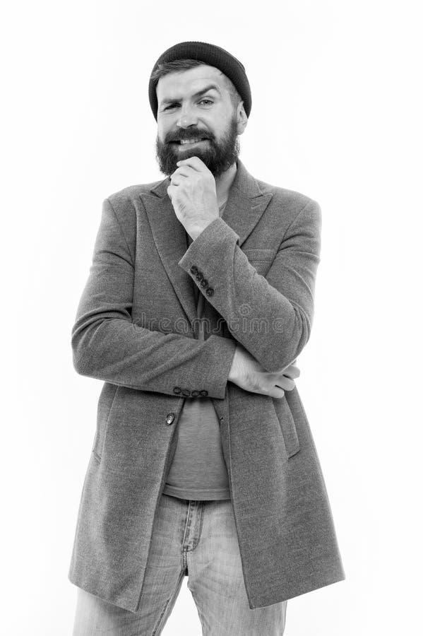 男装与男装观念 留着胡须的时髦时尚外套和帽子 一种时尚的装束 图库摄影