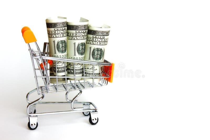 Amerykańska nota bankowa we wzorze rolu na małym wózku Amerykańskie pieniądze krążyły po świecie środki pieniężne do zapłaty,środ zdjęcie royalty free
