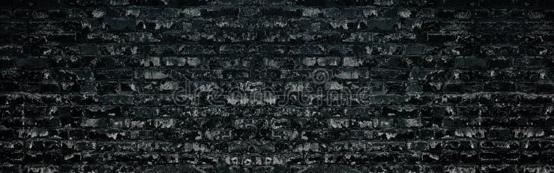 Textura de parede de tijolos pretos O velho cenário de alvenaria grande e assustador Fundo sombrio de brickwork curado fotografia de stock