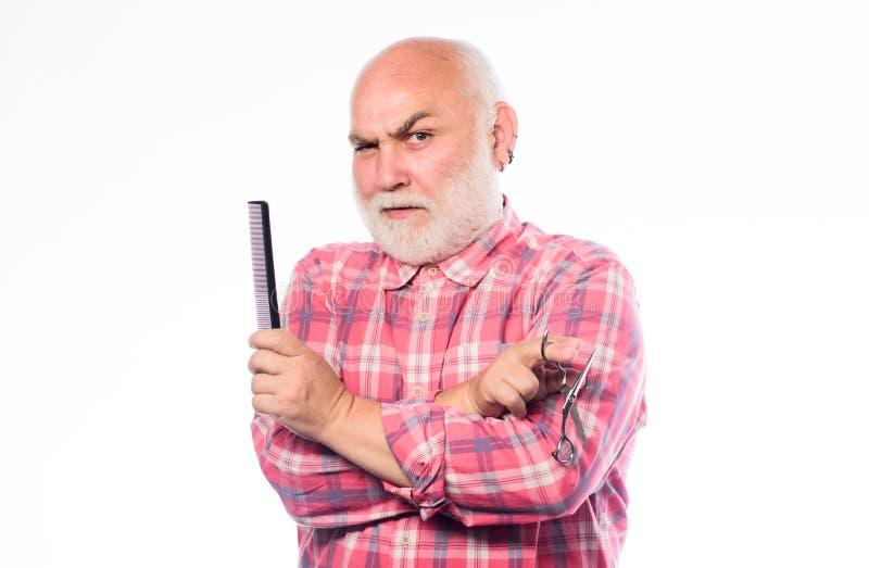 称呼胡子的人有胡子的英俊的发式专家理发师用途工具 r 男性理发 r 理发师用途 图库摄影