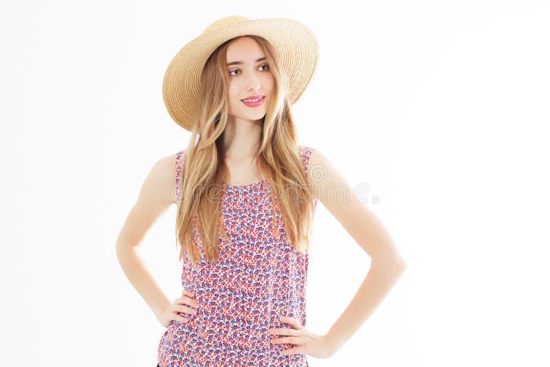 E 帽子的俏丽的女孩 在时髦的夏天成套装备的女性模型 香草颜色 花姑娘 库存图片
