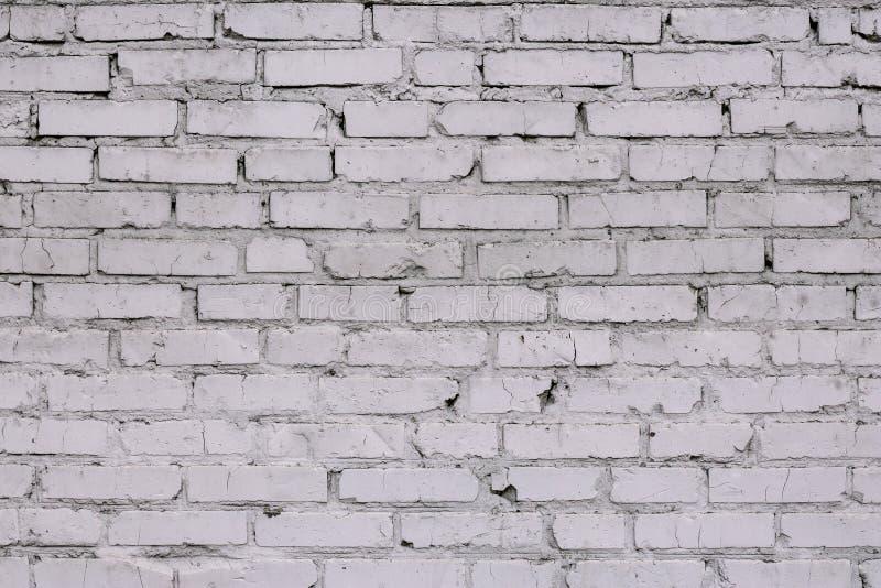 Vintagebakgrund för gammal vit tegelvägg Retro-täppning av texturen från den vita tegelväggen Ljus tegelvägg Väggcementbackar arkivfoto