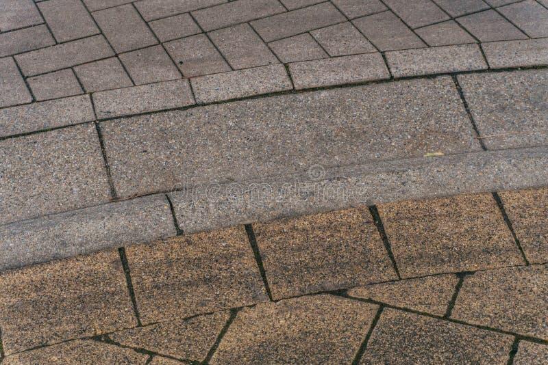 Route de la pierre de brique grise. Voie de trottoir claire, texture du trottoir. Route photo libre de droits