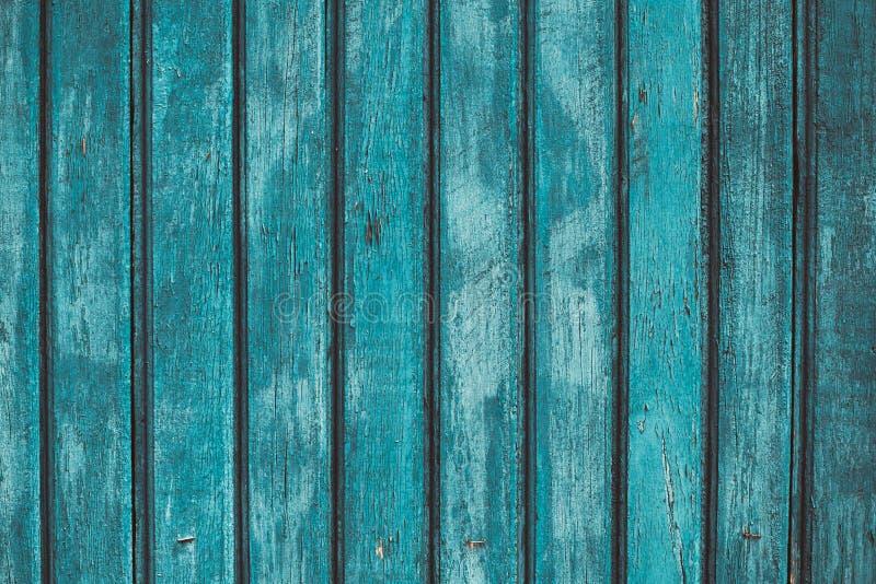 Sjofele gestreepte houten omheining Donkergroene en blauwe oppervlakte van hardhout Houtpatroon, geschilderde plank, eiken vuile  stock foto's