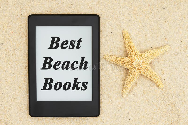An e-reader on the beach for your summer reading royalty free stock image