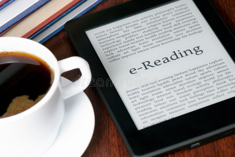 E-Reading. E-Reader and a cup of coffee stock image