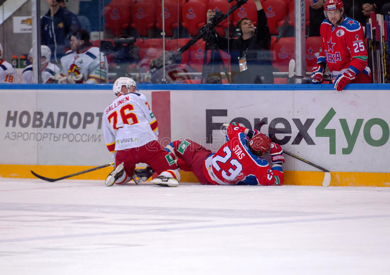 E. Sallinen (76) and A. Stas (23) fall down royalty free stock images