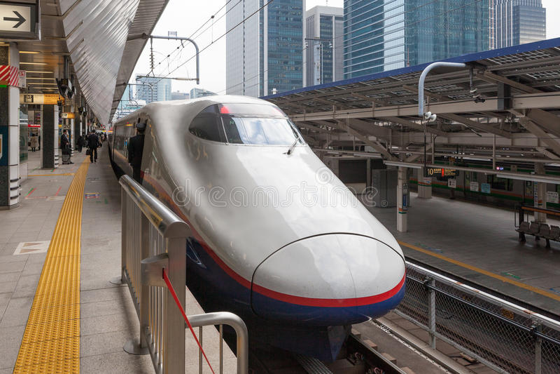 E2 Series bullet (High-speed or Shinkansen) train. TOKYO - APRIL 10, 2013: The white E2 Series bullet (High-speed or Shinkansen) train. It service as Asama( royalty free stock photo