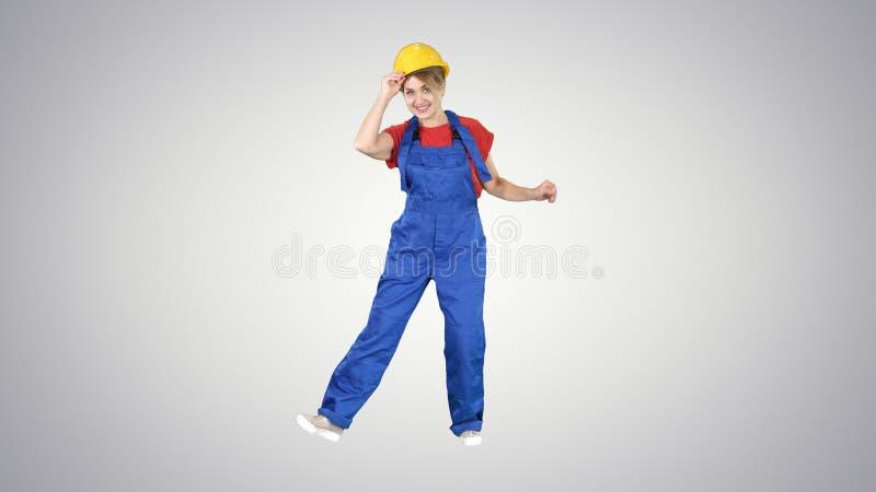 ?e?skiego pracownika budowlanego ?mieszny taniec na gradientowym tle obraz stock