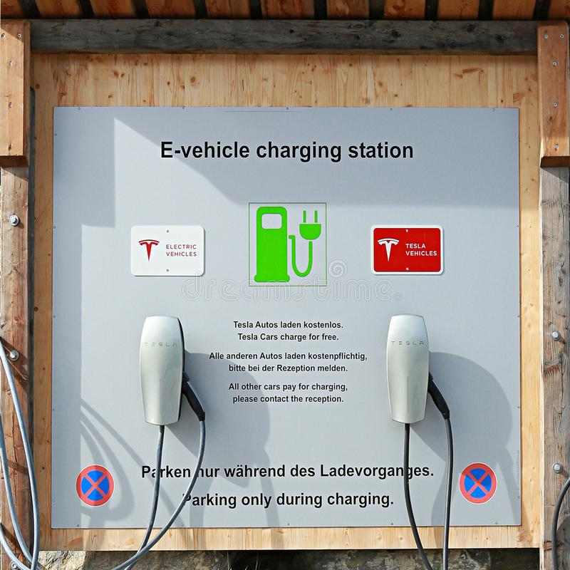 E-vehicle charging station at the public parking royalty free stock images
