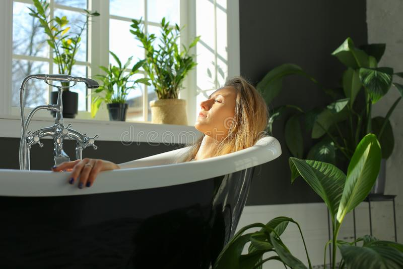 Calm relaxed woman in bath stock image