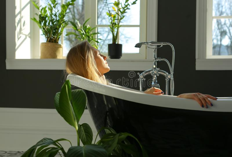 Calm relaxed woman in bath stock photo